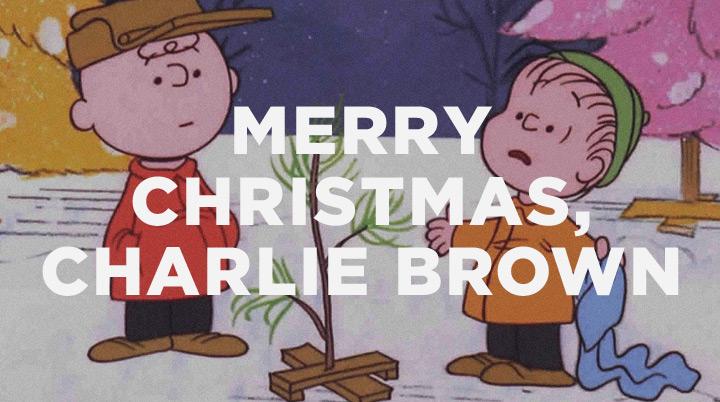 Charlie Brown and Linus talking around the scrawny Christmas tree
