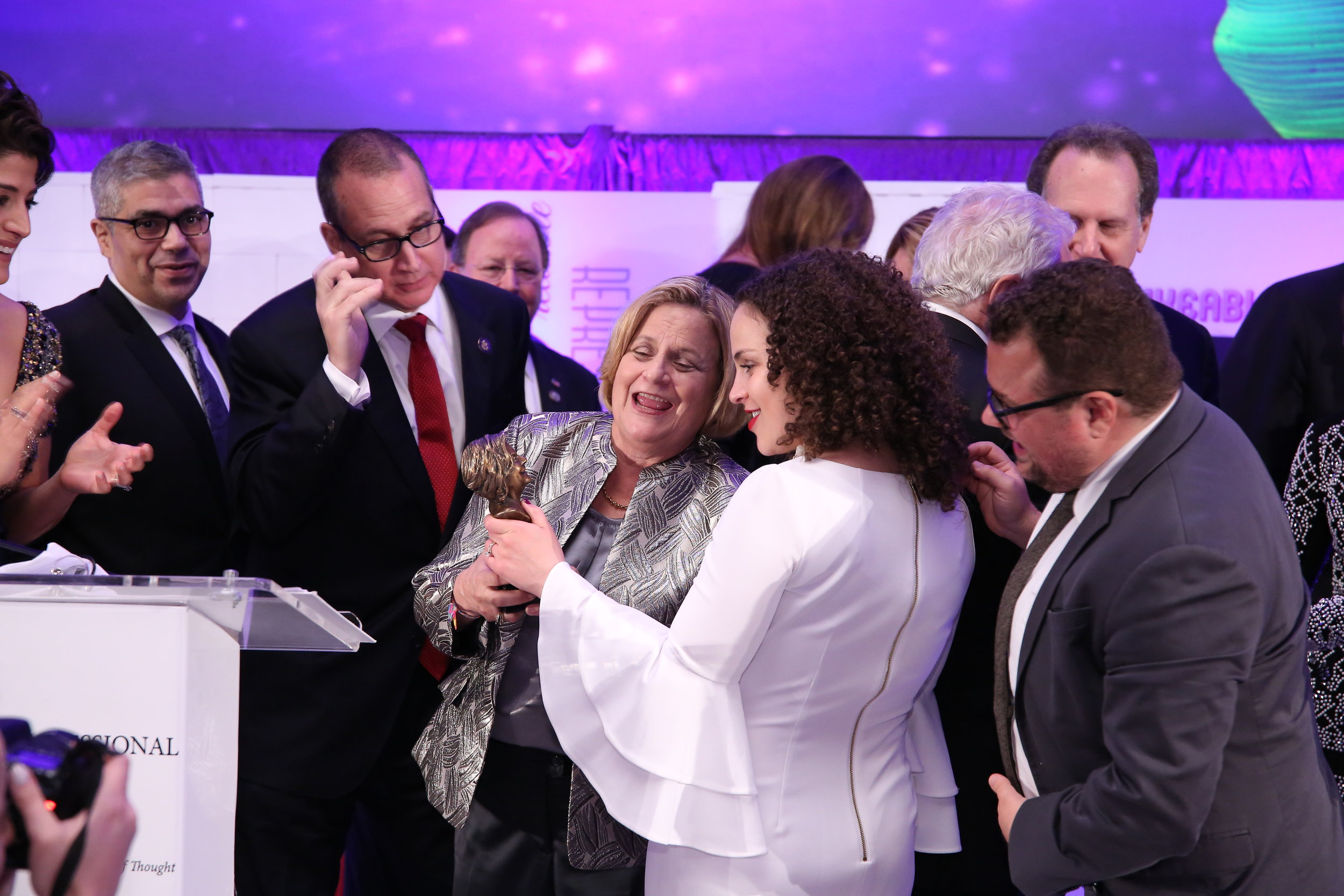 IRL Patricia Rigo look at award.jpg