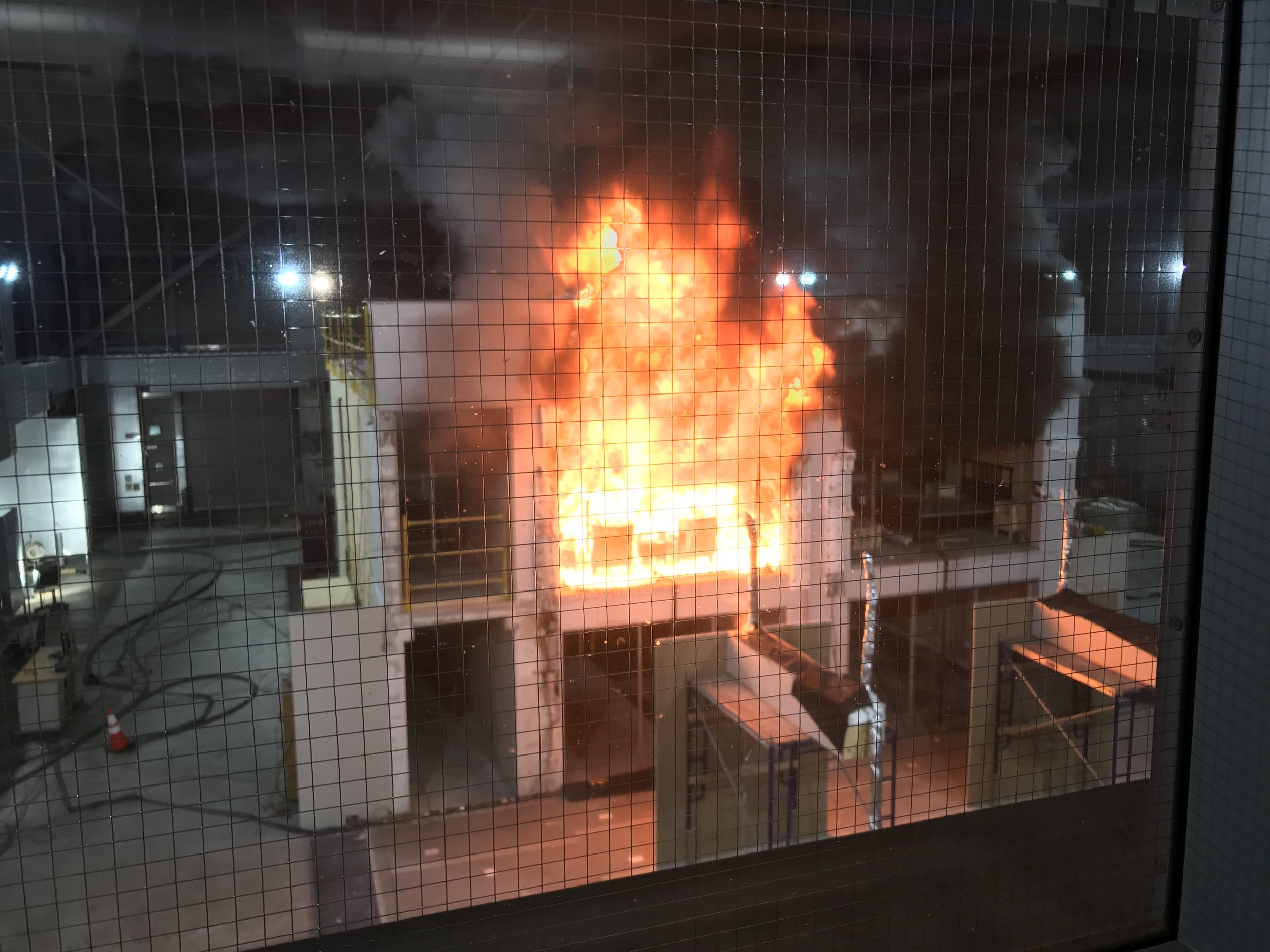 Fire Test No. 3, at the US Bureau of Alcohol, Tobacco and Firearms outside of Washington DC, showing a Mass Timber compartment structure being burned for up to four hours without sprinklers to test the fire capacity of Mass Timber. Photo: Susan Jones