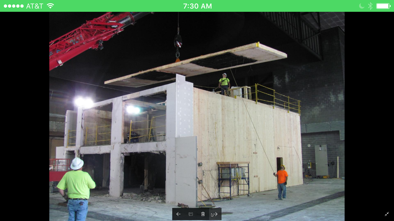 Fire Test No. 2, at the US Bureau of Alcohol, Tobacco and Firearms outside of Washington DC, showing the mass timber roof panel being lifted out, after burning for four hours without sprinklers. Photo: Jason Smart, American Wood Council.