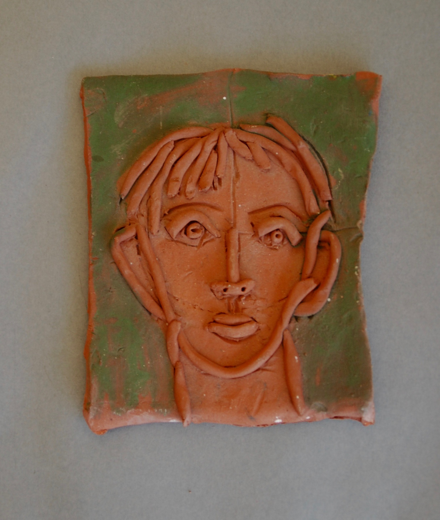 Small tile - head of a man with coils, 1997