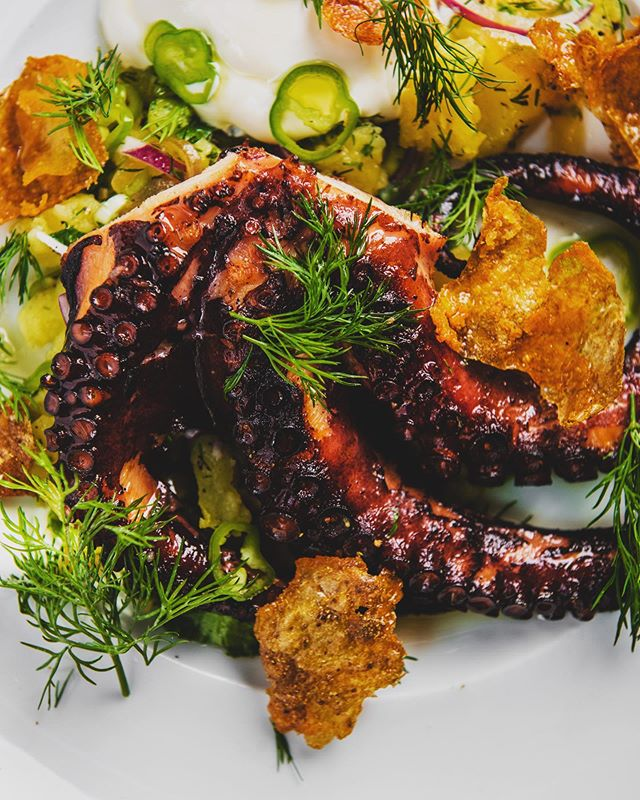 Roasted Octopus 🐙 with Taboon Baked Potatoes, Sour Cream, Dill, Cilantro, Scallions  #nycfood #nycrestaurants #taboon #bustannyc #eatingnewyork #newyork #upperwestside #cocktails #octopus #israel #foodi #tasty
