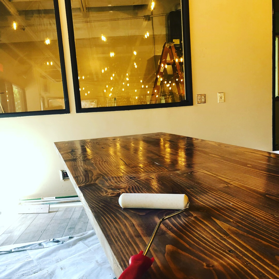 Coating the hand crafted Taproom Tables