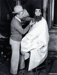Actor, Buster Keaton, with Monte on set,  Spite Marriage .