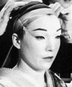 Shirley MacLaine in a Geisha make-up.