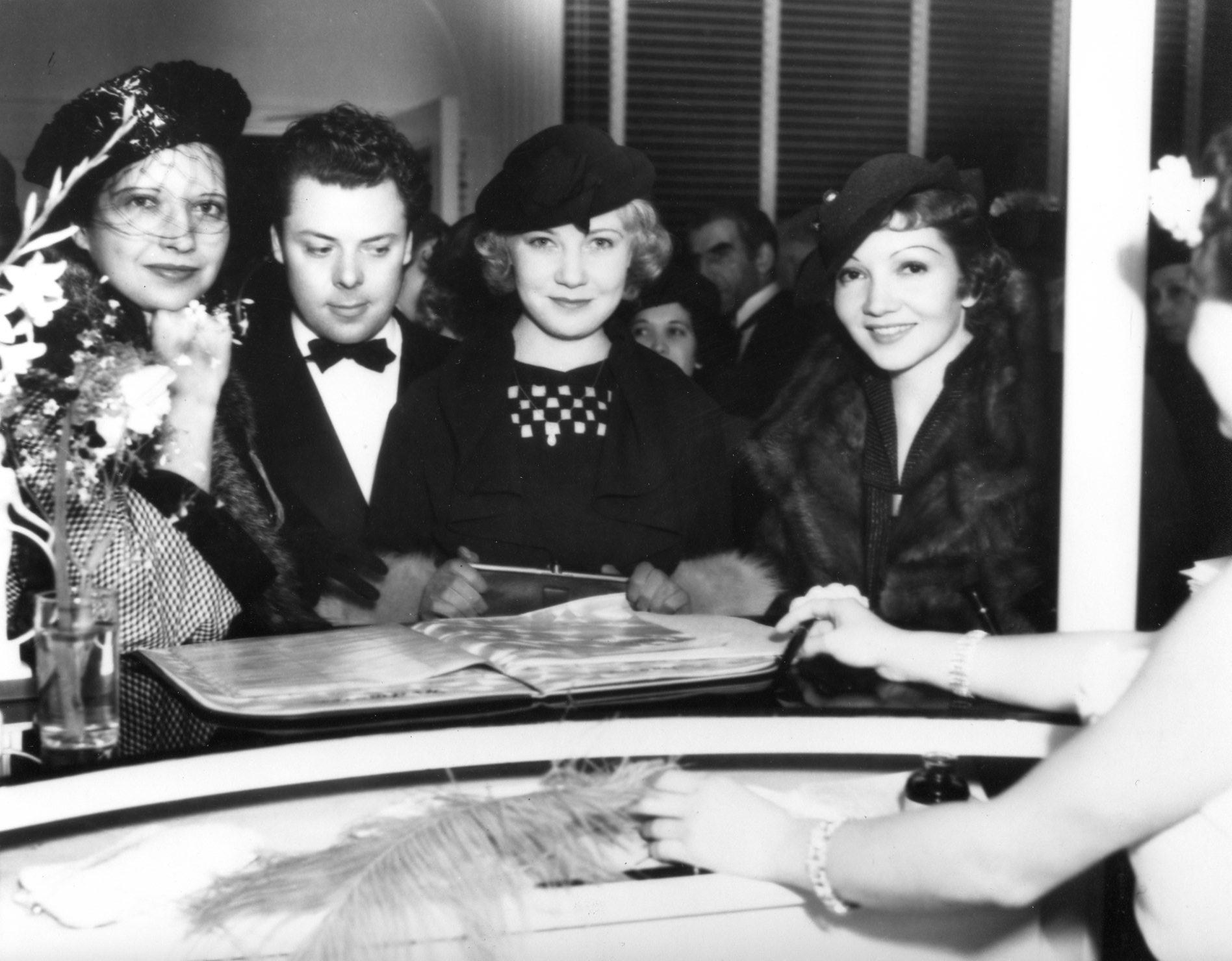 From left to right: Kay Francis, Perc Westmore, Una Merkel, and Claudette Cobert. Westmore Salon opening, April 1935.