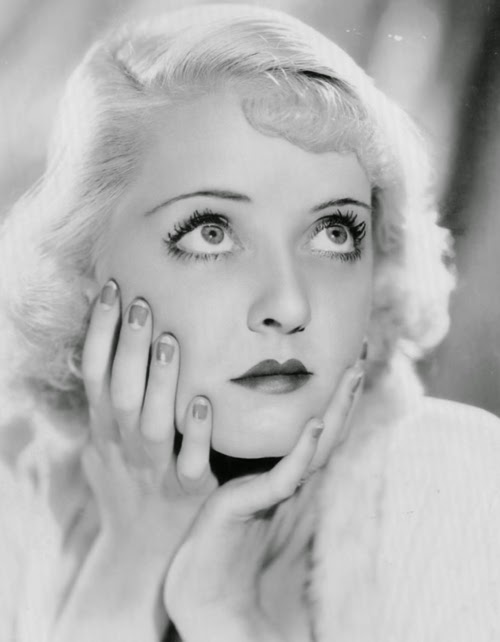 Bette Davis, bee stung lip.