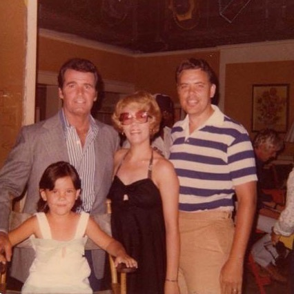 """I didn't get a chance to post this yesterday, 5 years ago, Mr. James Gardner passed away. My Grandpa Bob was the Art Director for his show, the Rockford Files. They were close friends throughout the years. This photo was taken,on set, in 1976. My pretty Mom, wearing her disco glasses and my handsome father, who had the starring role in my life. Just so you understand the Westmore tie-in, my Grandfather Bob Crawley, was married to Muriel """"Mully"""" Westmore. """"Mully"""" was Ern Westmore's daughter. I love the family history. my Grandpa Bob worked at Universal for many years on Quincy M. D., Simon and Simon, Baa Baa Black Sheep, Marcus Welby, M.D., and even designed the facade of the Great Moments with Mr. Lincoln, the original tea cup ride and the Peter Pan Fly Through at Disneyland.  There is much to be learned through history and to first understand where we came from to have a sense of where we are going. We are all capable of great things.  #westmoresofhollywood #robertcrawley #jamesgardner #rockfordfiles #disneyland #greatmomentswithmrlincoln #teacupride #peterpanride #familyhistory #universal #1976 #minime #lovewhatido #mywhy"""