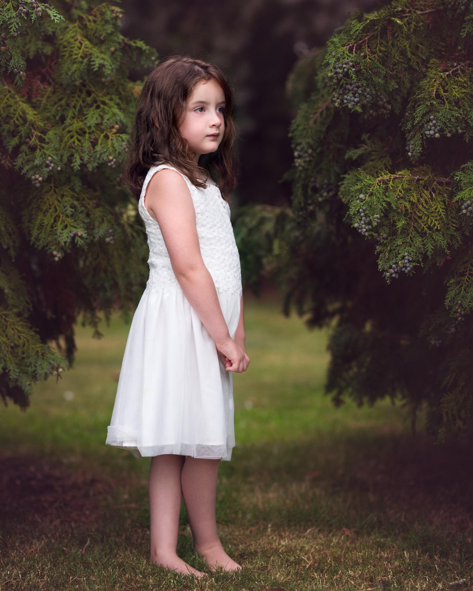 Girl between trees | Children's Photography