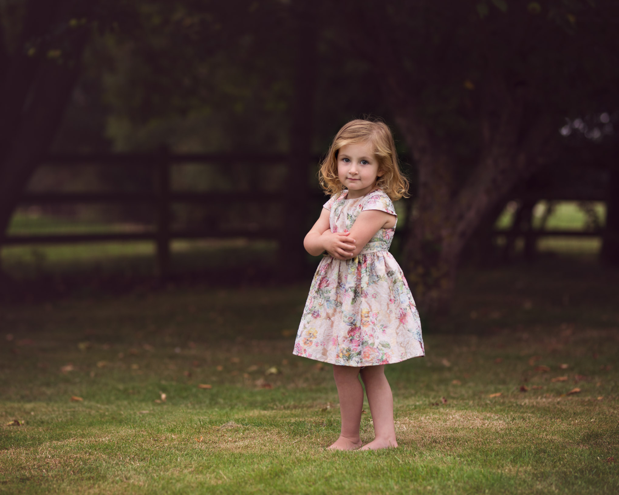 Toddler posing with arms crossed in gardens | Children's Photography