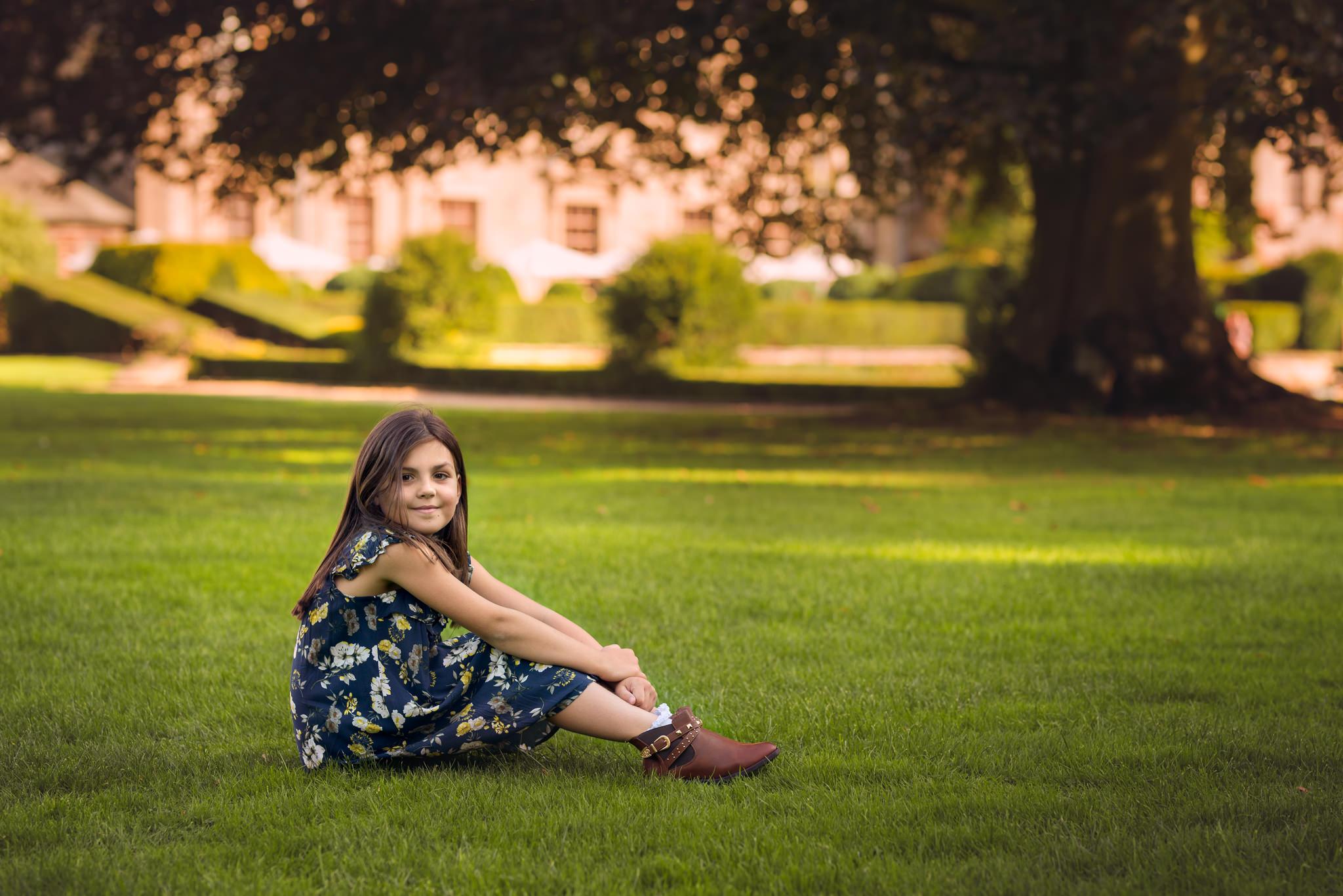 Girl holding needs on grass | Children's Photography