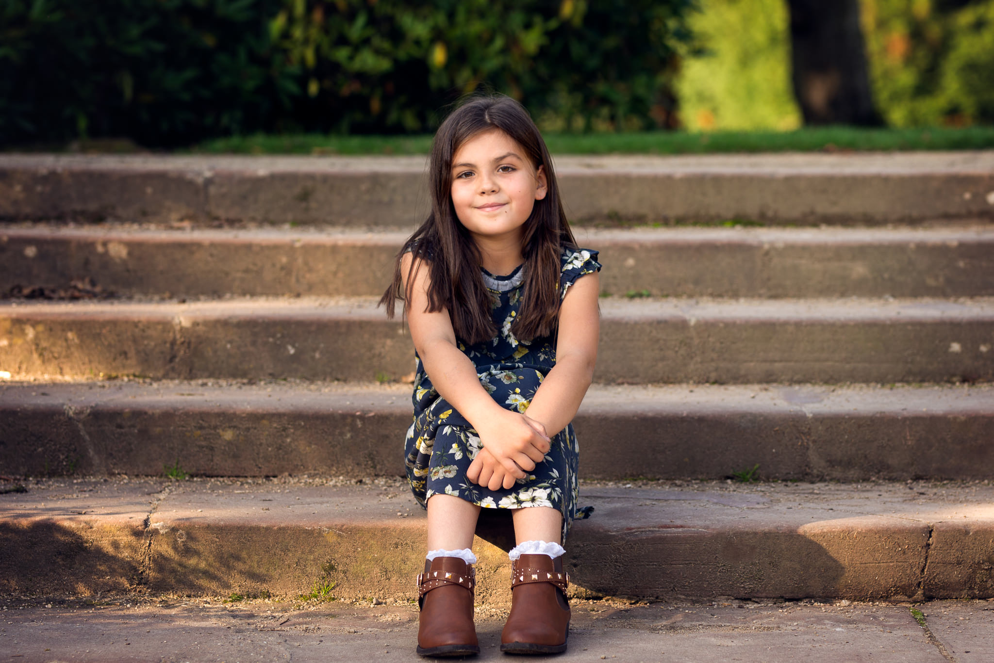 young girl sitting on step in golden sunshine | Children's Photography