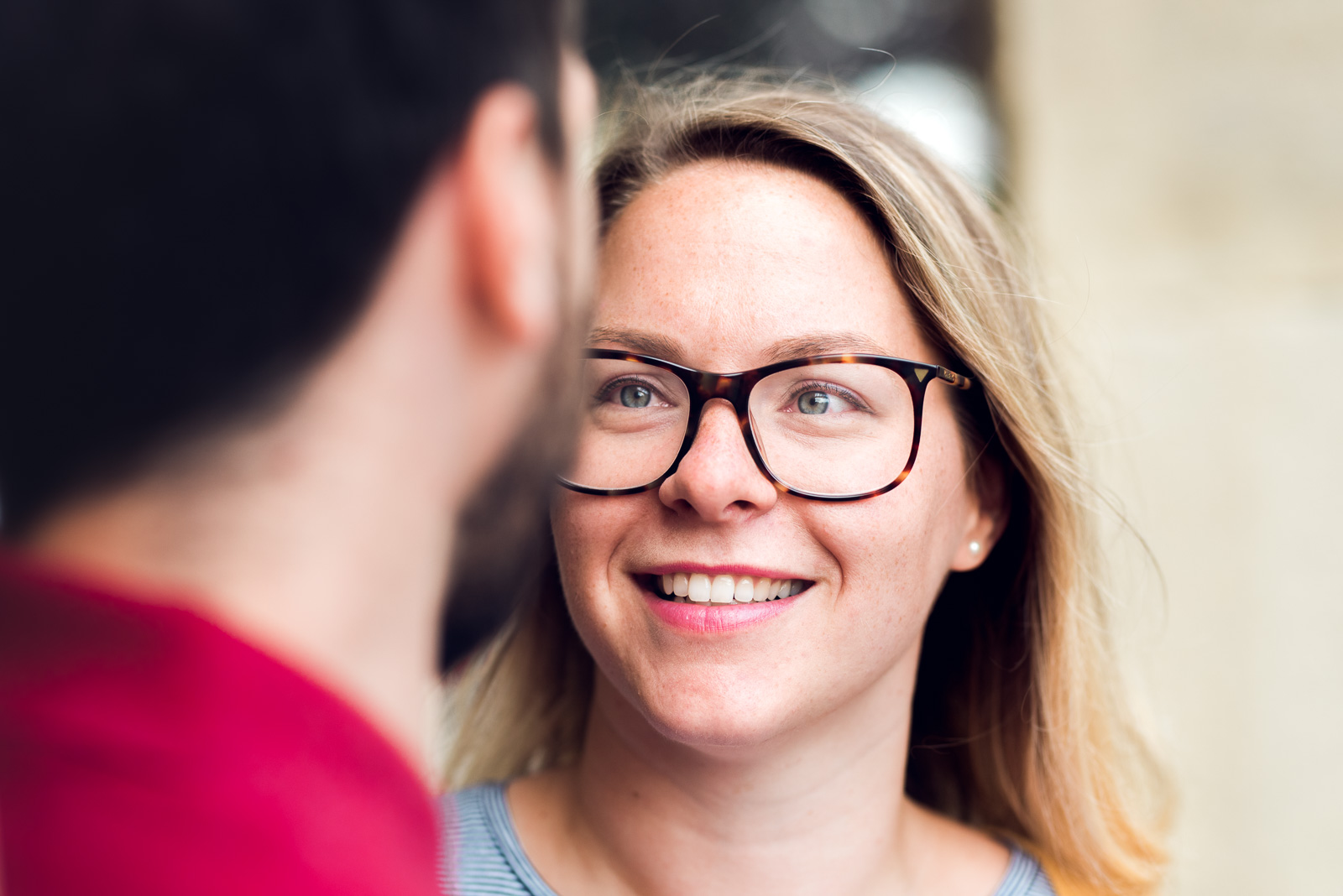 Couple making eye contact smiling - Cotswolds Wedding Photographer