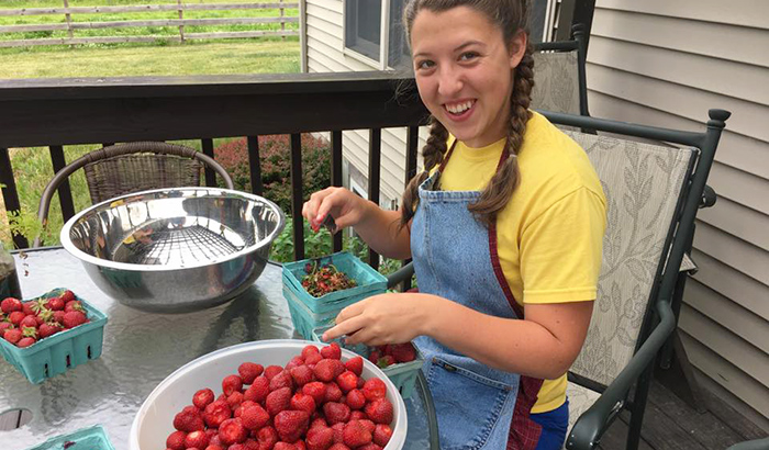 Destiny cleaning organically grown local strawberries