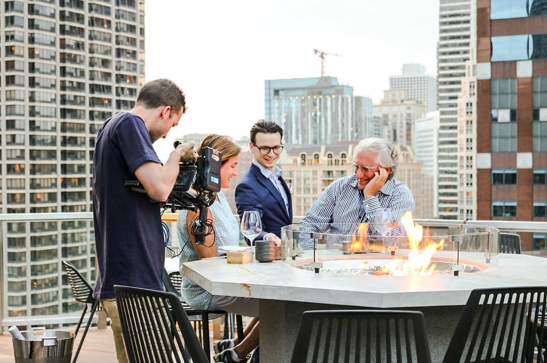 Laurence Geller (far right)at Noyane, the rooftop restaurant at Conrad Chicago. Photo by Victoria Kent.