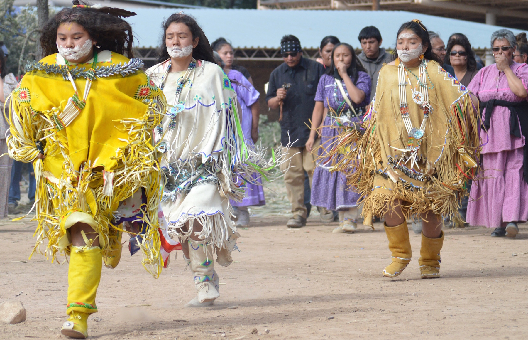 Every Independence Day at the Mescalero Apache tribal lands in New Mexico, the public is invited to witness the tribe's traditional puberty rites, a series of rituals deeply connected to the Apache deity White Painted Lady. Photo credit:  indiancountrymedianetwork.com
