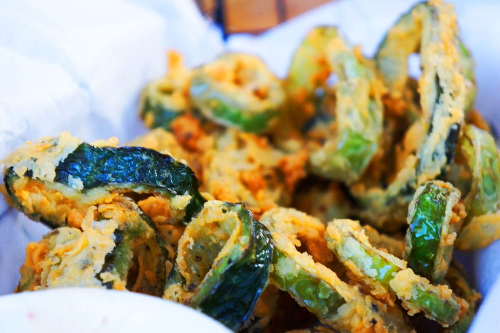 GRILL CALIENTE FRIED GREEN CHILI RINGS: Green chili, poblano, and jalapeño rings served with chipotle ranch.