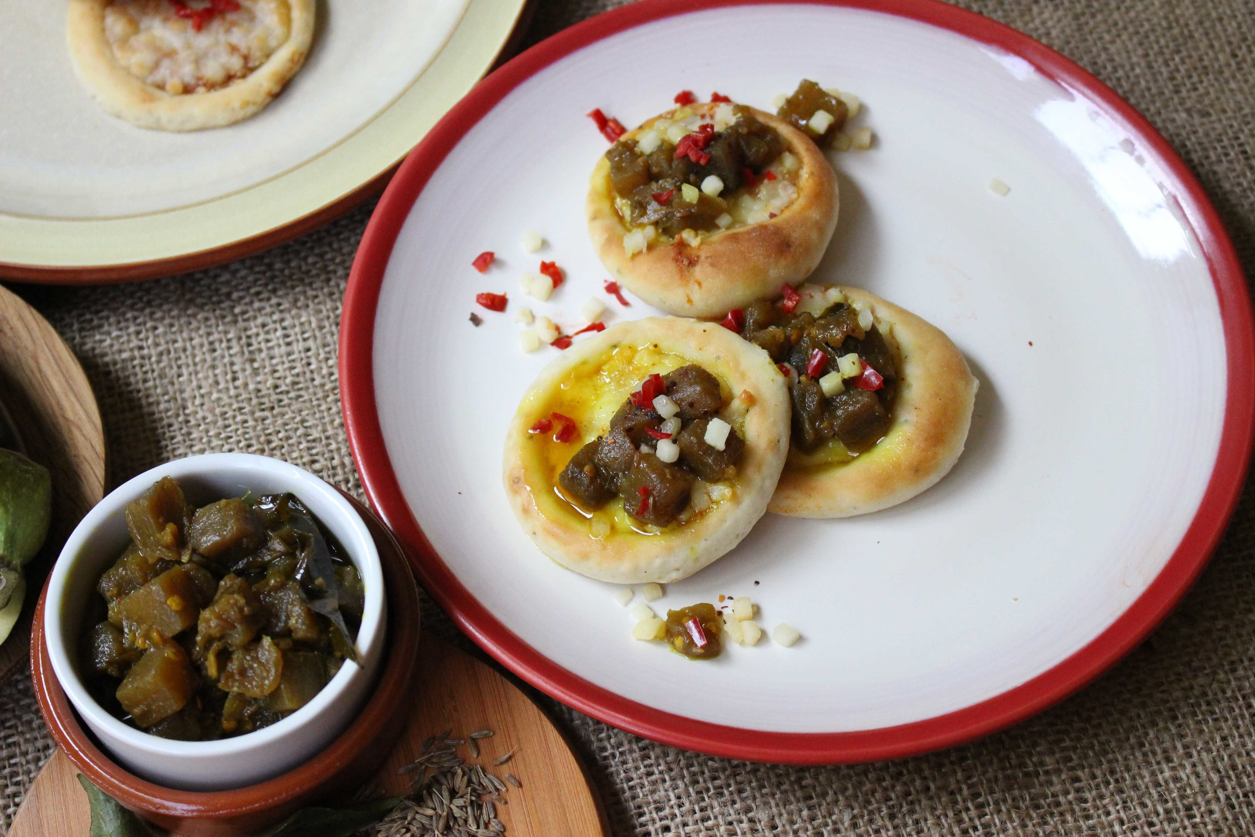 mini pizza bianca with smoked scamorza and brinjal caponata