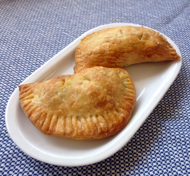 aubergine and comte hand pies with cumin and curry leaves