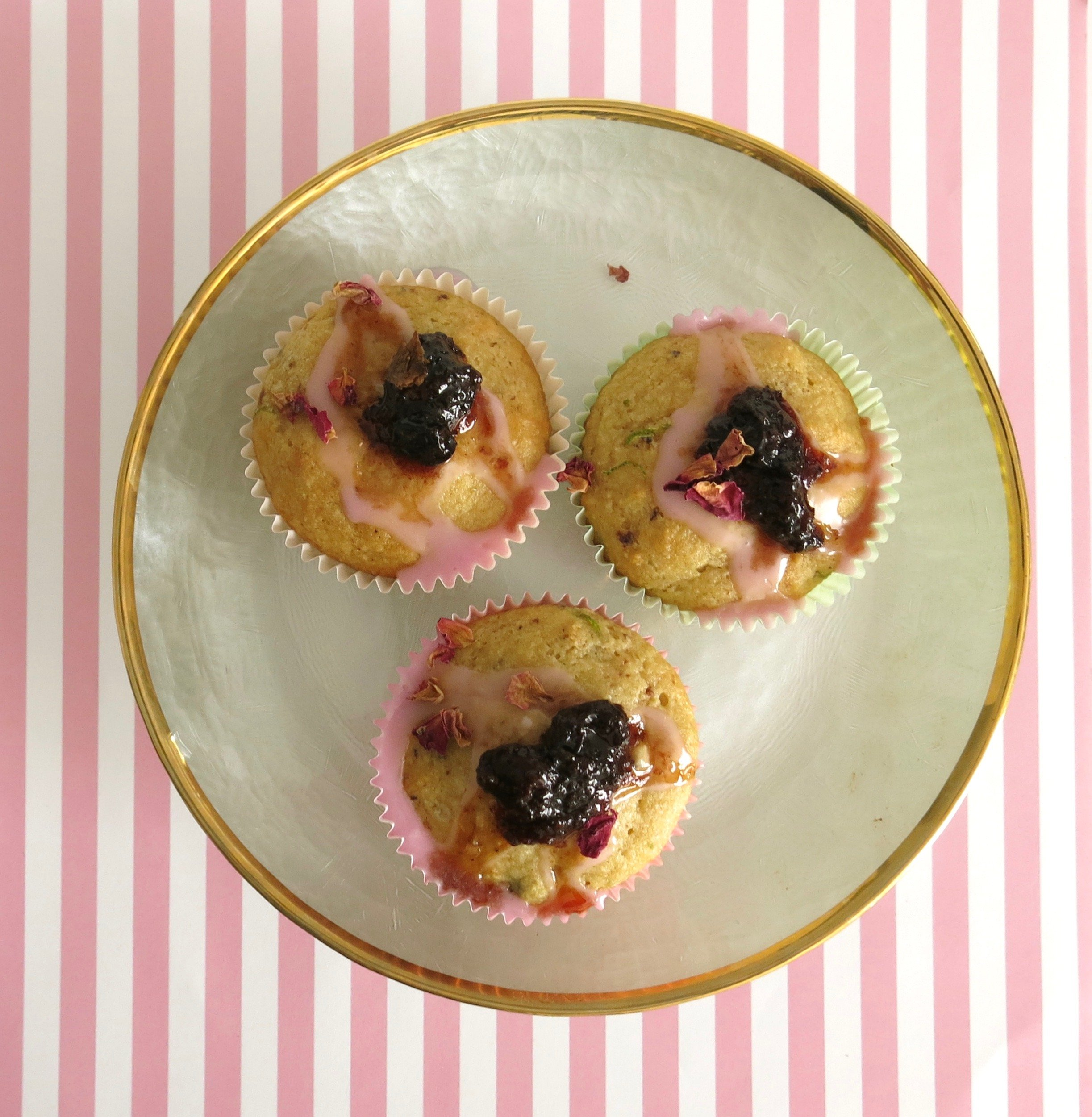 almond and spiced raisin fairy cakes with rose glaze