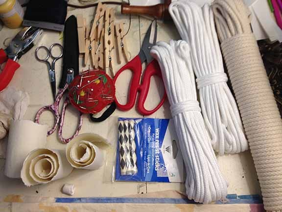 Various types of threads, strings, ropes, scissors, etc. to create enchanting fabrics.