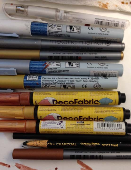 Metallica and opaque markers and pens.