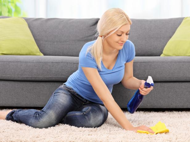 Woman Cleaning Carpet.jpeg