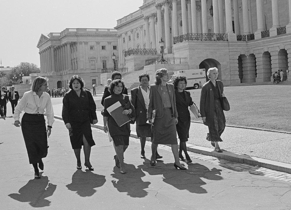 Keating, M., photographer. (1991) [U.S. Representatives including Nita Lowey, Pat Schroeder, Patsy Mink, Jolene Unsoeld, Eleanor Holmes Norton and Ileana Ros-Lehtinen walking by the U.S. Capitol on their way to the Senate]. Washington D.C, 1991. [8 Oct] [Photograph] Retrieved from the Library of Congress,  https://www.loc.gov/item/2015645194/ .