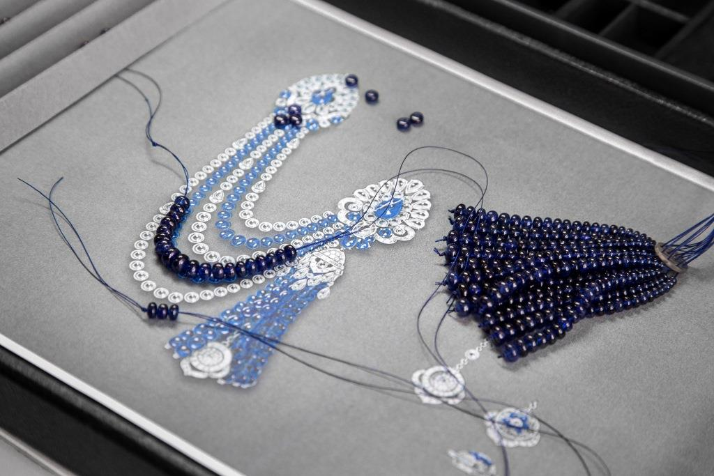 each_sapphire_bead_is_individually_threaded_onto_the_tassel_element_1_0.jpg