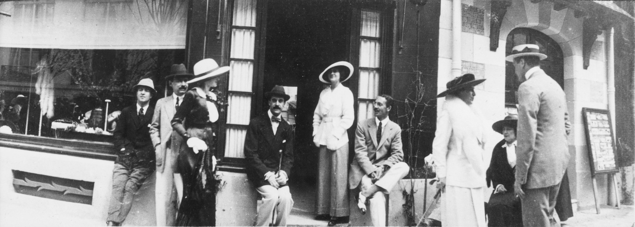Gabrielle Chanel and friends in front of her Deauville boutique, with Boy Capel on her right, 1913.
