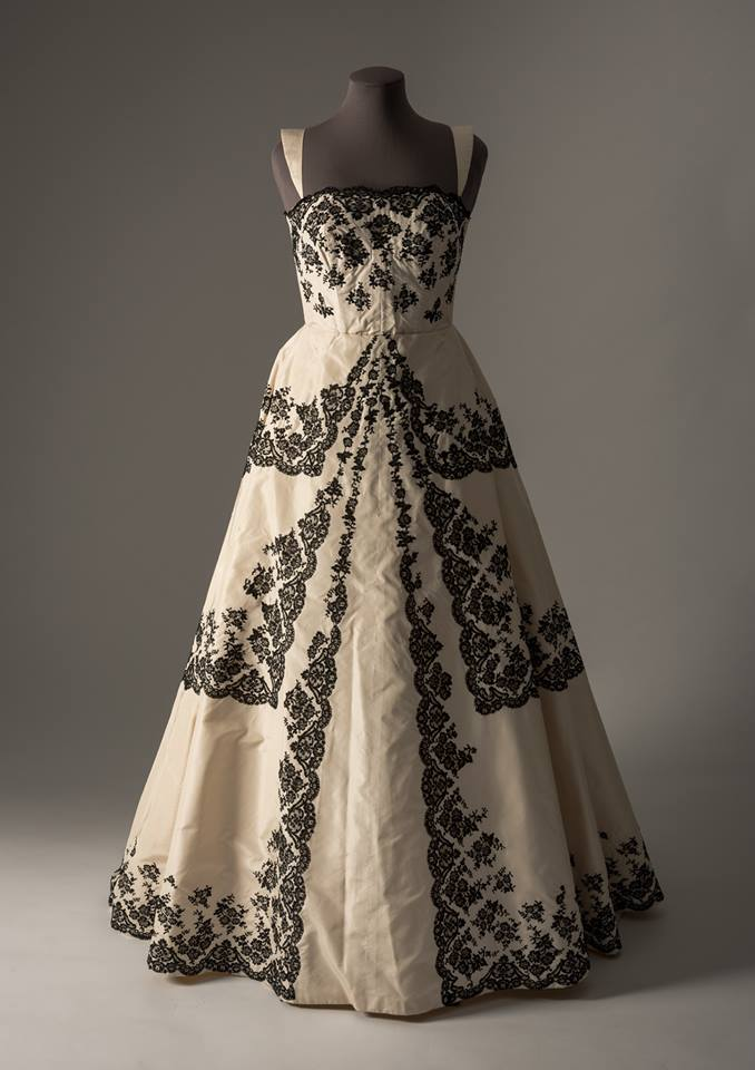 A cream silk evening gown with applied black lace by Portuguese couturier Amalia Machado, ca. 1959