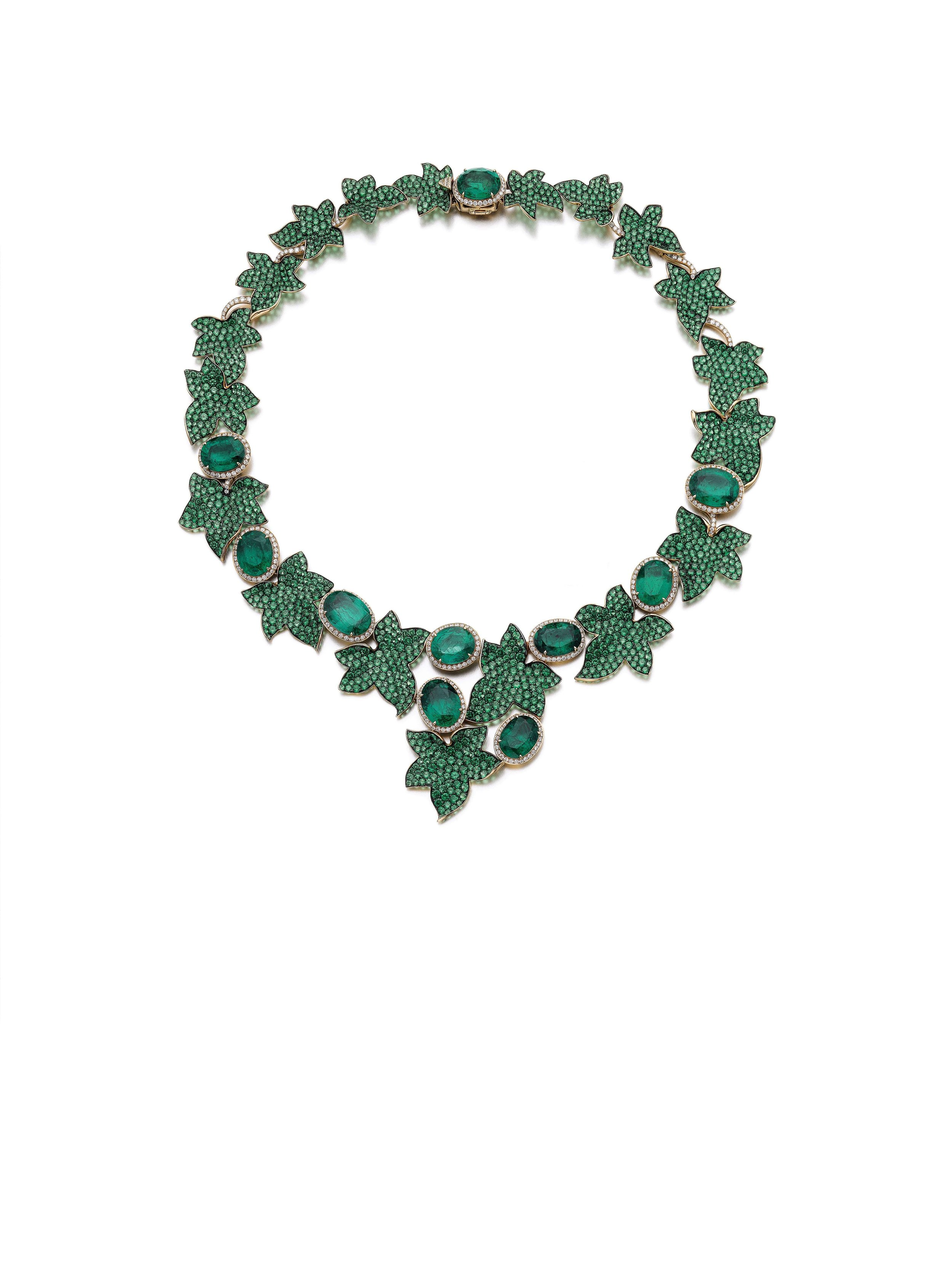 Emerald, tsavorite and diamond necklace, 'Ivy' Of foliate design, pavé-set with circular-cut tsavorites, alternating with gold motifs set with oval emeralds