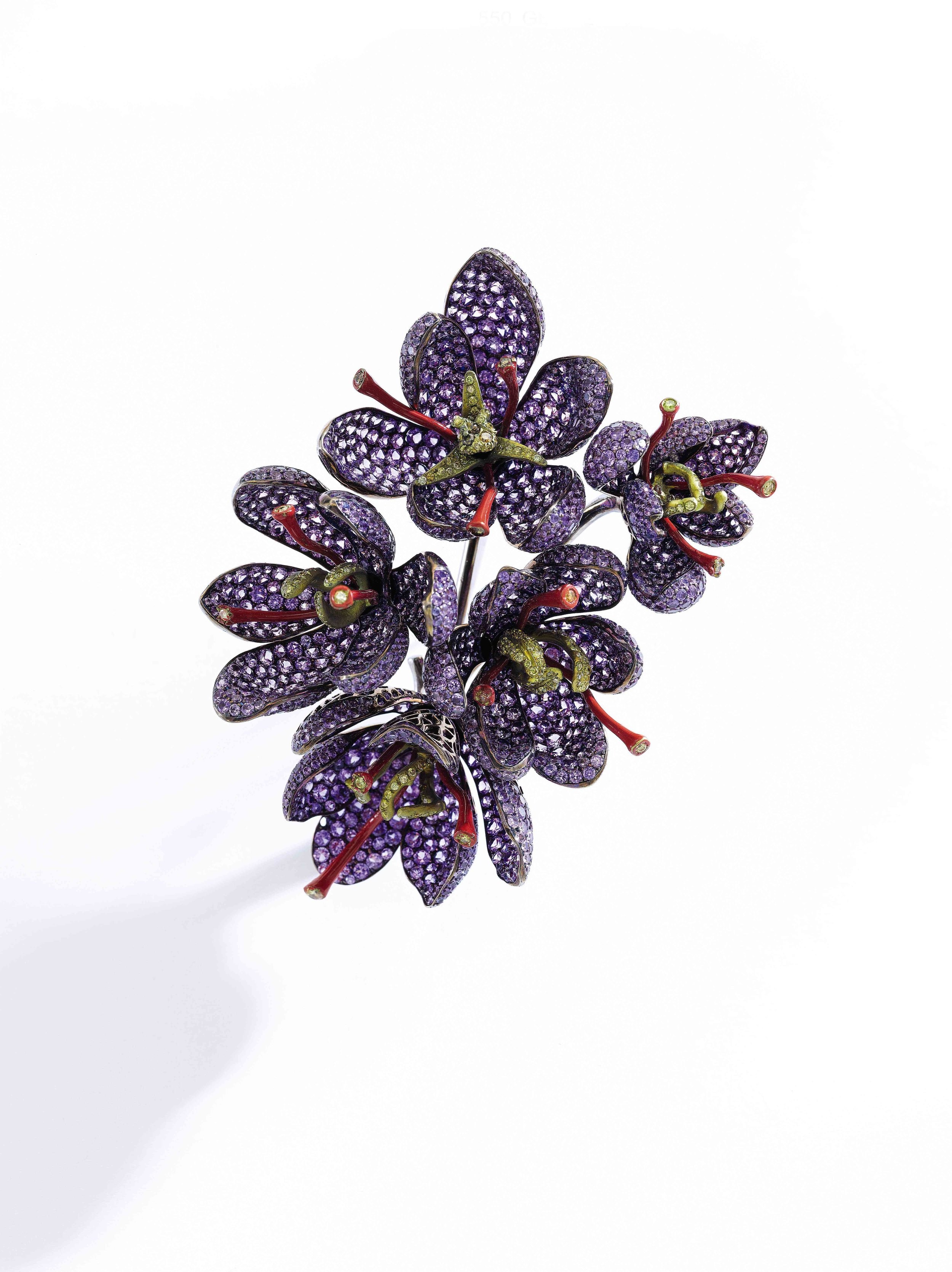 Purple sapphire, enamel and diamond brooch, 'Saffron' Pavé-set with purple sapphires, the pistils applied with red enamel and embellished with brilliant-cut diamonds of yellow tint