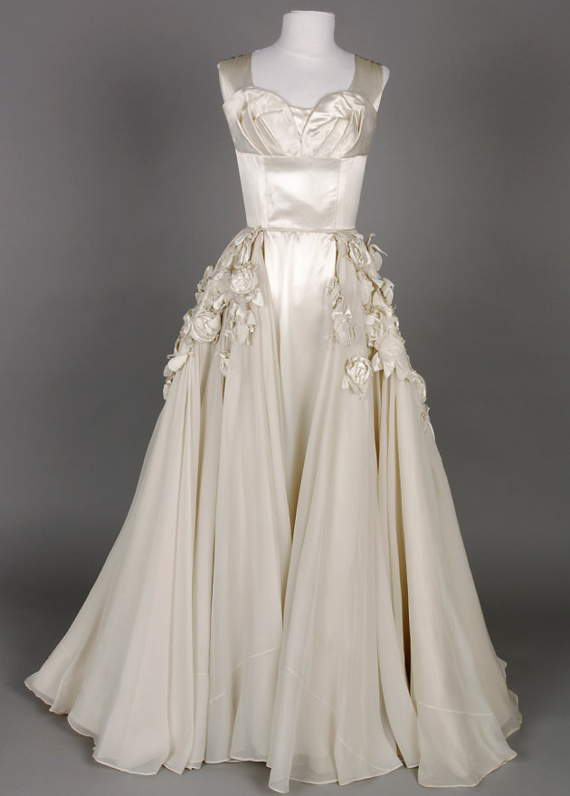 Worn Betty McInerney , who arried 1952. The dress is designed by Beril Jents (the famous Beril from Bondi) who was Australia's leading special occasion 'dressmaker'.