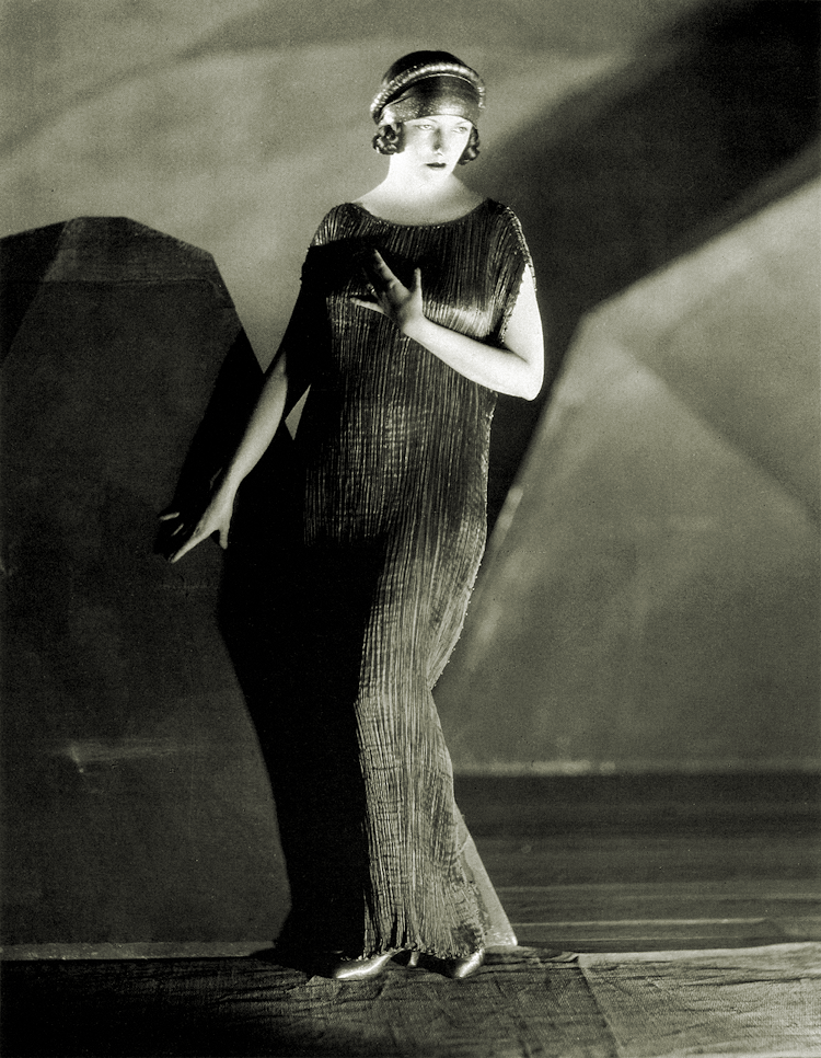 Natacha Rambova in a Fortuny Delphos, c. 1924. Photo by James Abbe.png