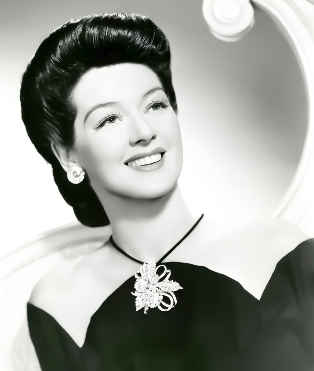 his pair of earrings worn by Rosalind Russell.jpg