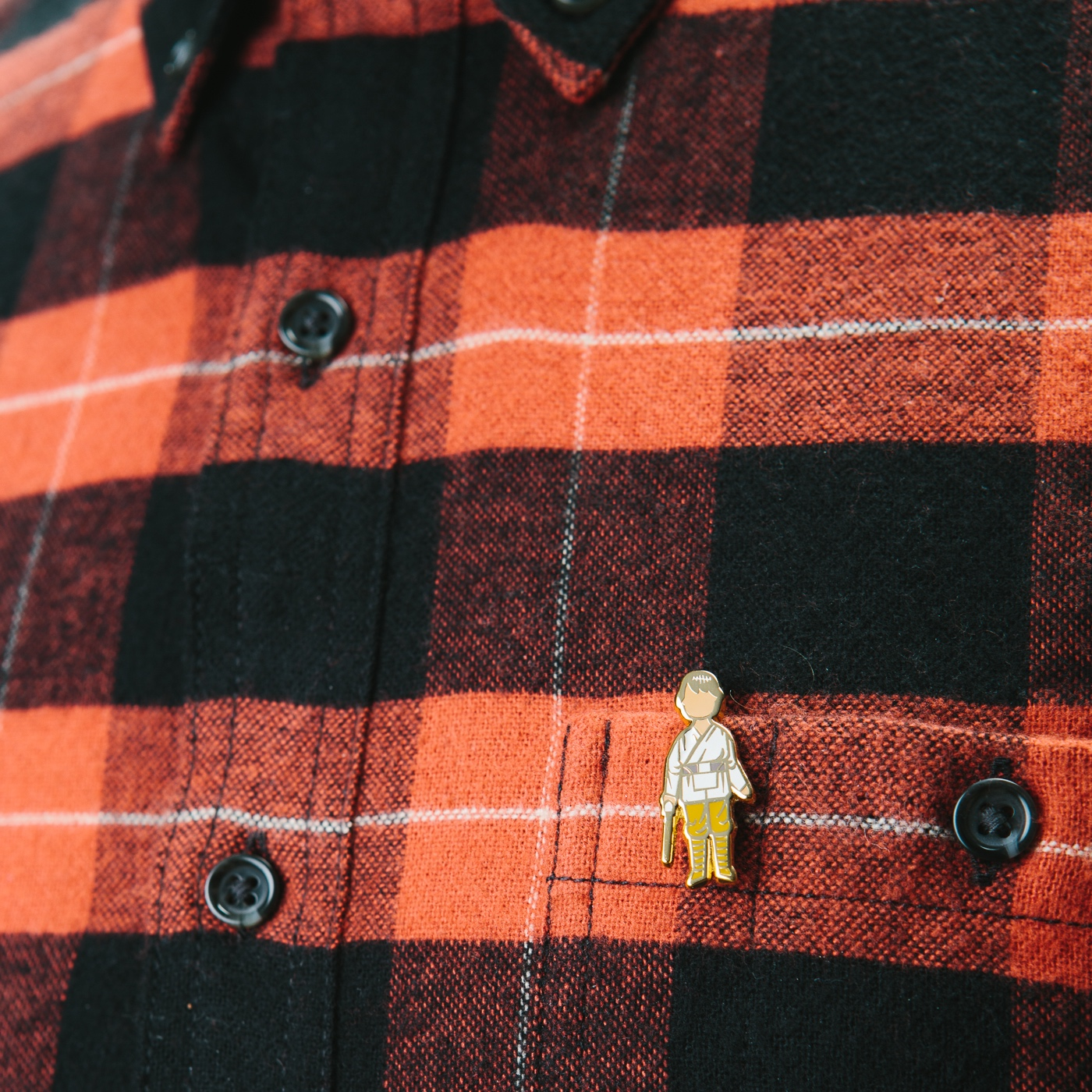 Farm Boy Action pin paired with red buffalo plaid.