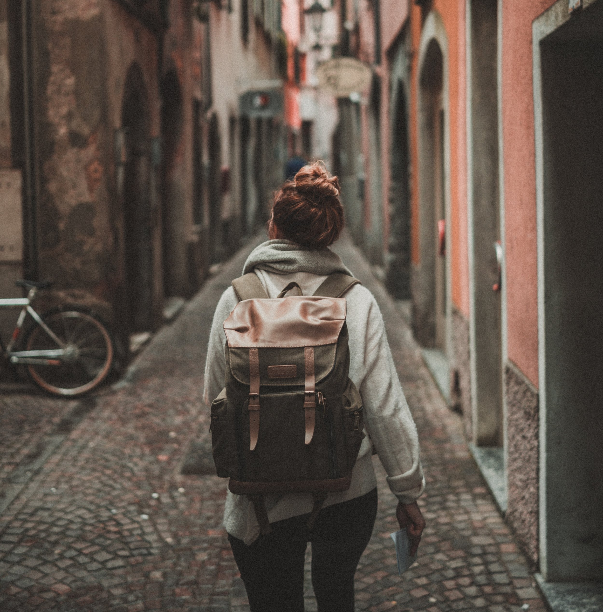 Girl with backpack on narrow European street © Timo Stern, cropped.jpg