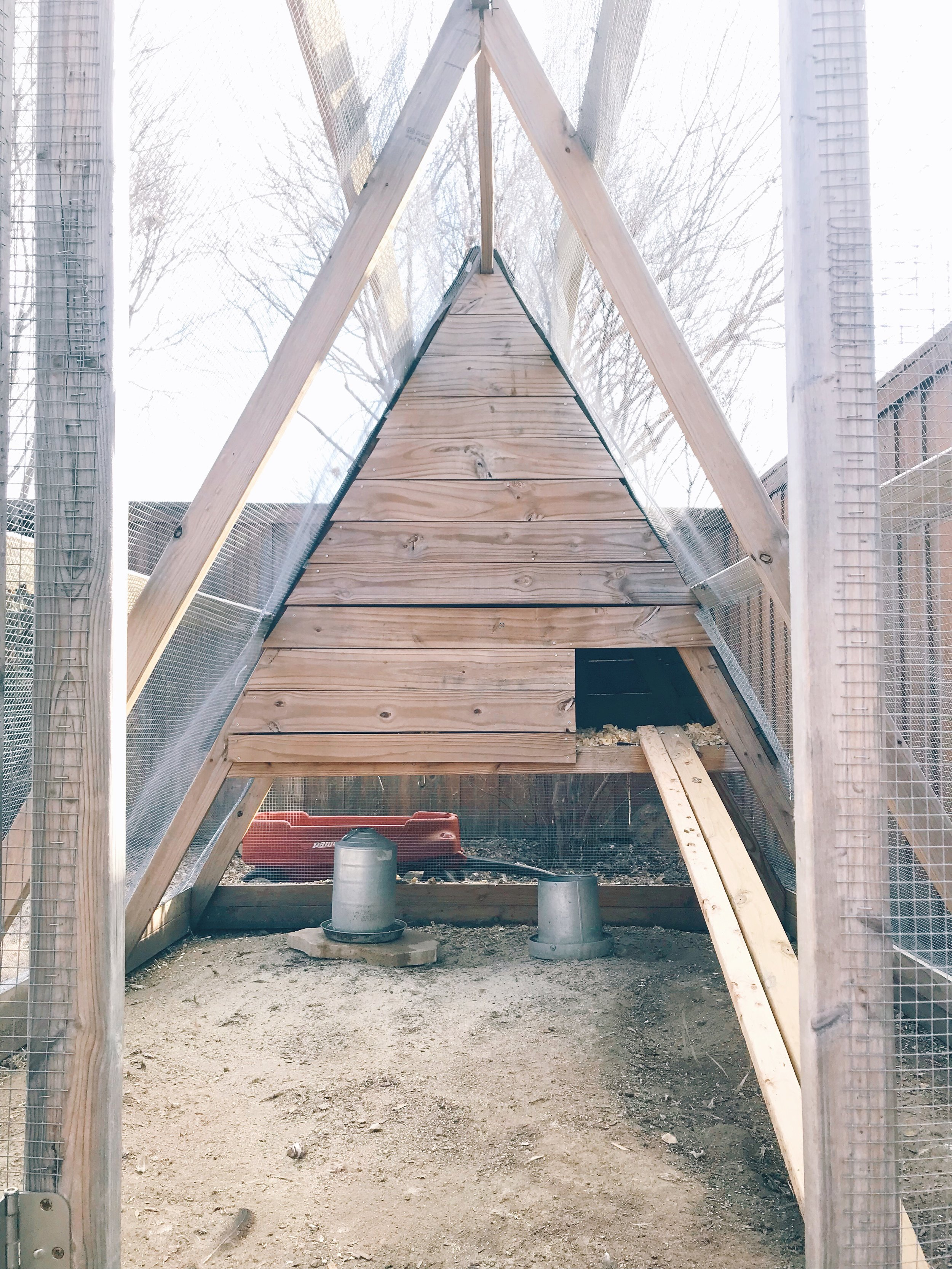 We were able to keep the feeder and waterer under the little hen house part of the coop, keeping it from rain.