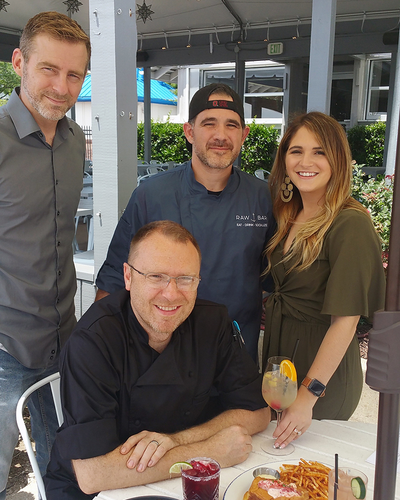 Raw Bar staff, from left to right: Service Manager Phil Von Eiff, Executive Chef Marc Dixon (seated), Chef de Cuisine Chad Medina, and Event Coordinator Niki Phillips