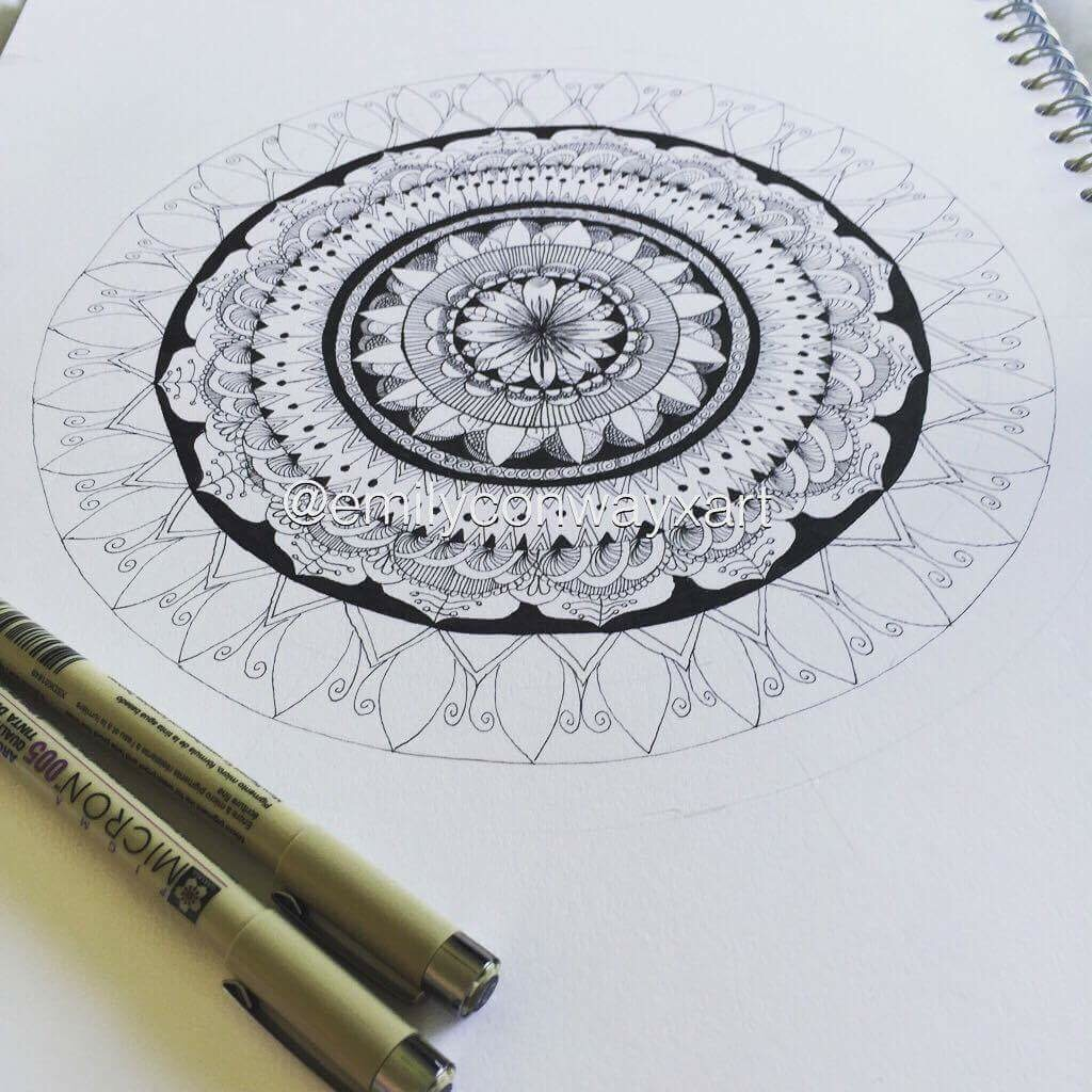 Step 2 - I built the mandala up using different patterns and making some areas lighter than others and making the patterns as symmetrical as you can go around the circle. It helps to draw those reference lines in pencil first so that it is easier to keep the patterns as similar as you can.