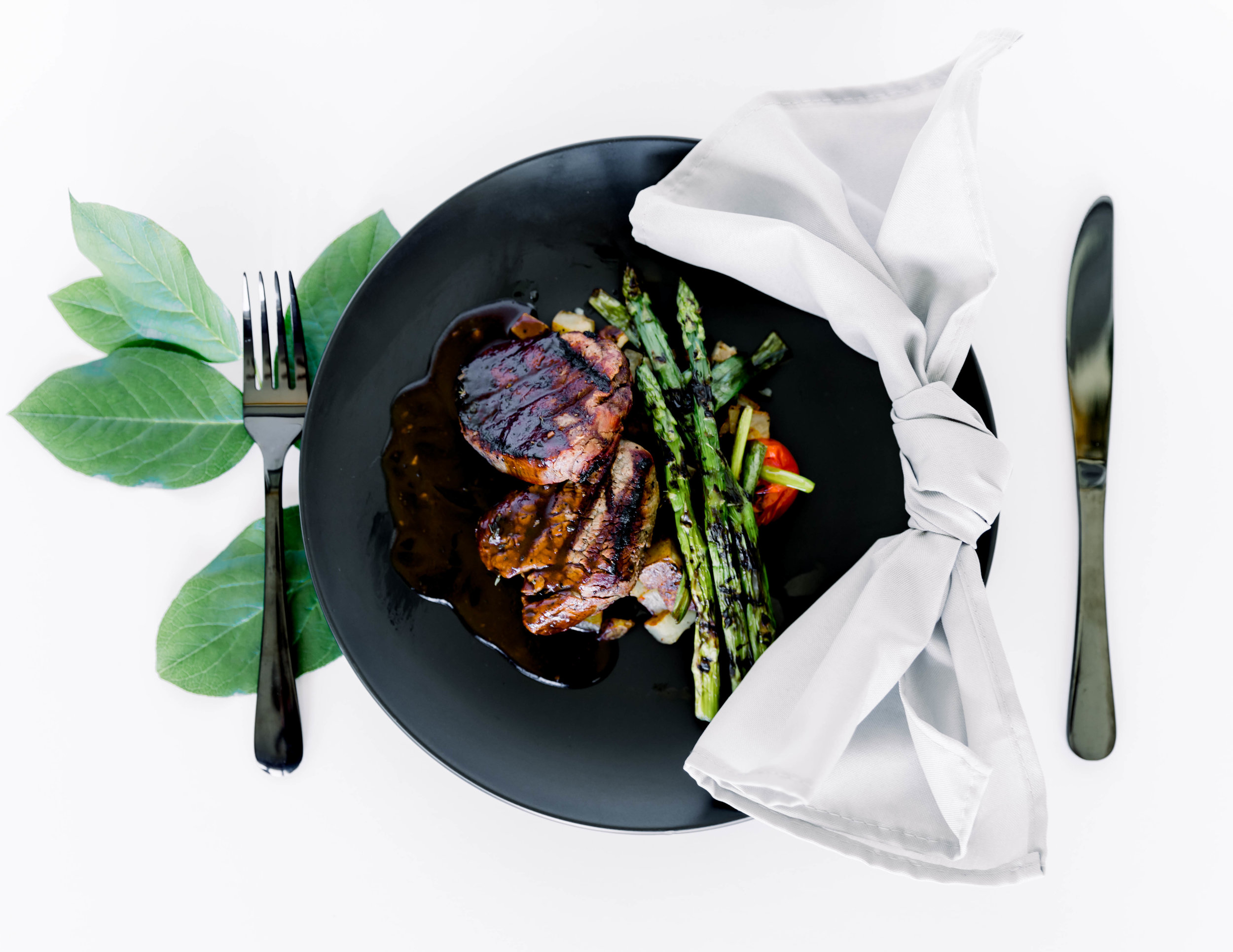 2- 4 oz. Grilled Filet Mignon with Herb Demi Glaze served with Potato Hash and Grilled Asparagus -