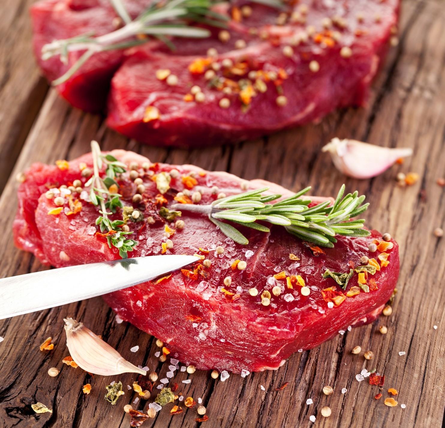 bigstock-Raw-beef-steak-on-a-dark-woode-44856208.jpg