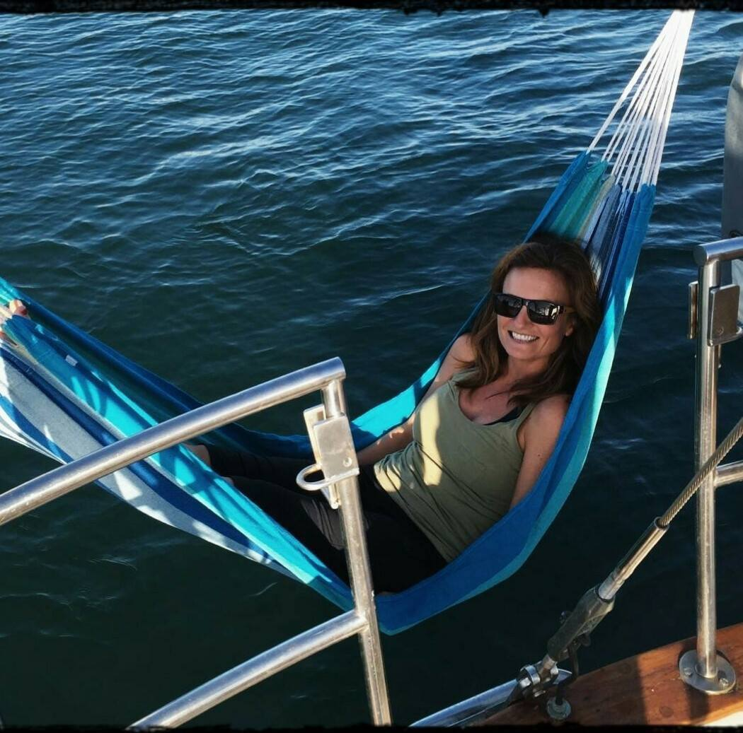 """This picture was 3 weeks after I left my job, anchored on the water for the night and this hammock was my new """"couch"""".  I would read books, magazines and watch seagulls above and fish below. These times were the best times!"""
