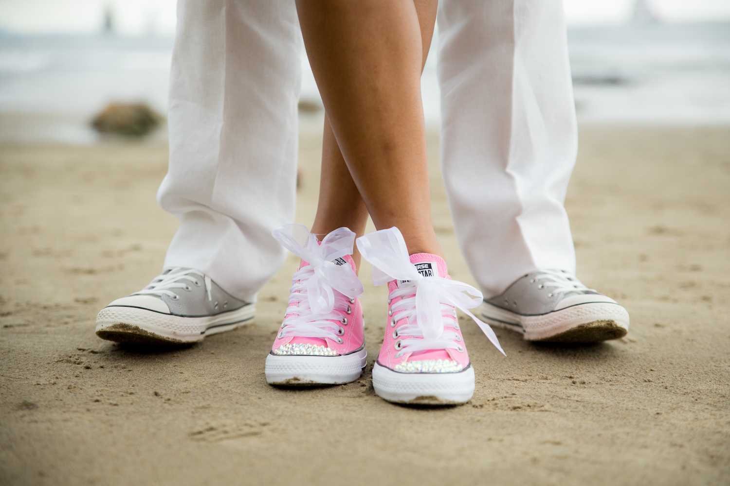 feet-crossed-pink converse.jpg