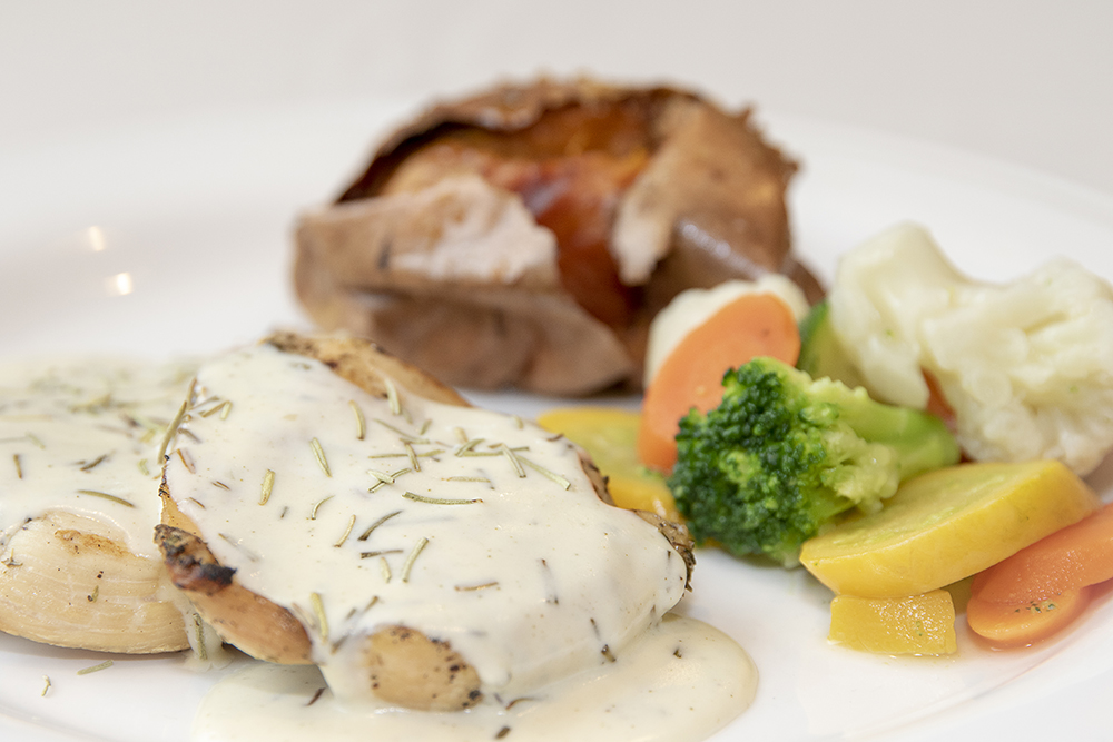 Grilled chicken breast served with rosemary cream sauce.
