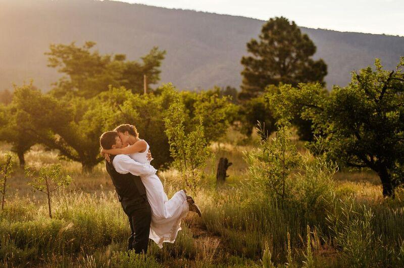 kissing in the field wedding.jpg