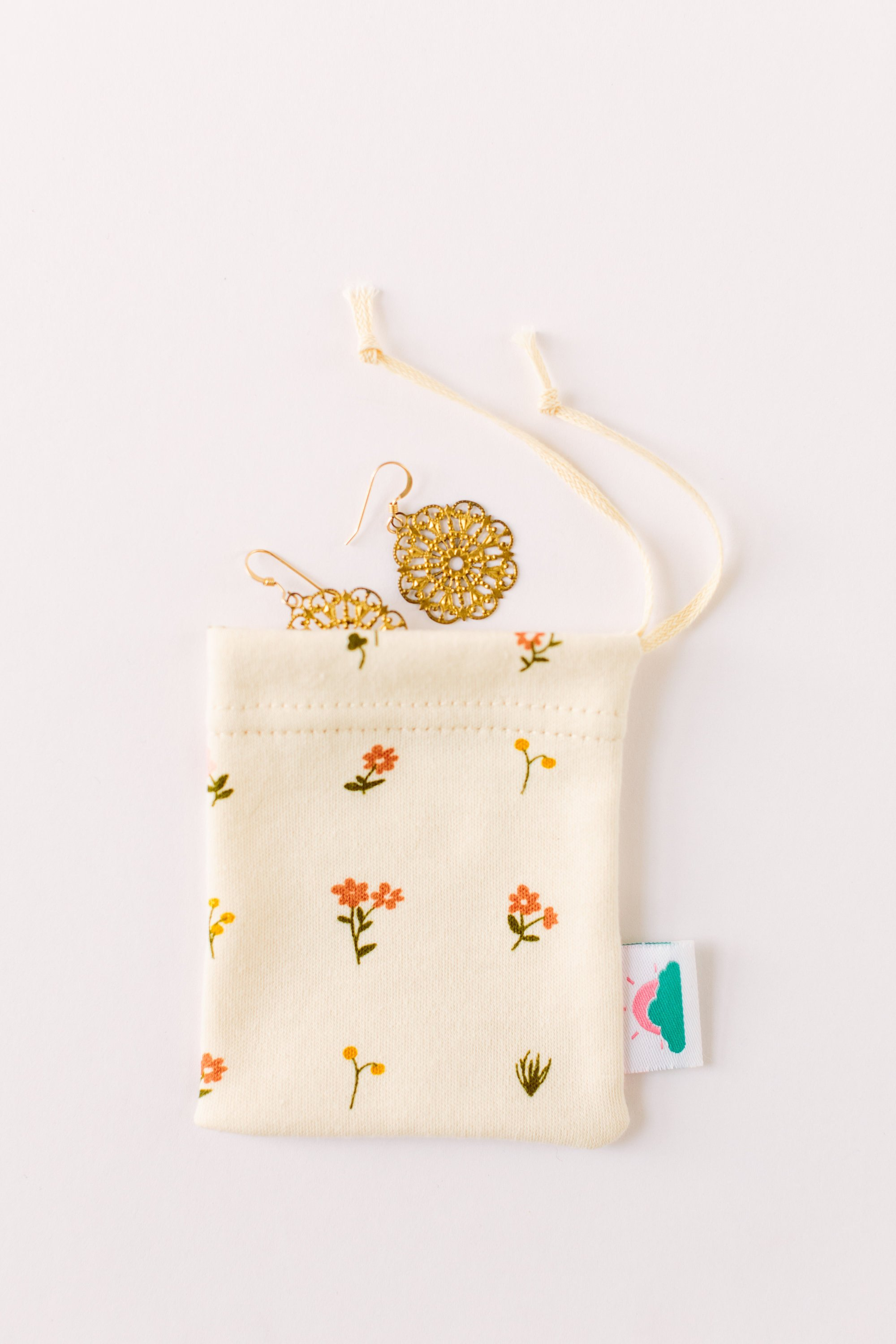 "Mini Drawstring Bag - Lakeshore Dry Goods | GOTS Certified Organic cotton | $4.50 with code ""STYLEFAIR"" for 15% offPerfect for jewelry, coins, pins, or traveling! These come in the cutest prints and are made from leftover scrap fabric."