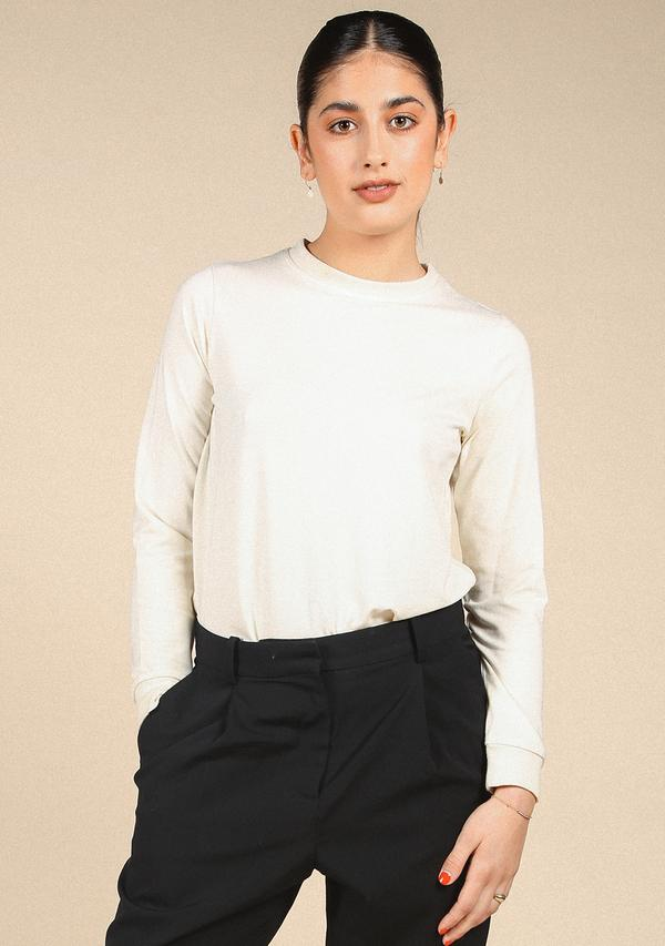 Cream Long Sleeve Tee - Poplinen   Made of sustainable materials   $48With a style this classic, you can't go wrong!