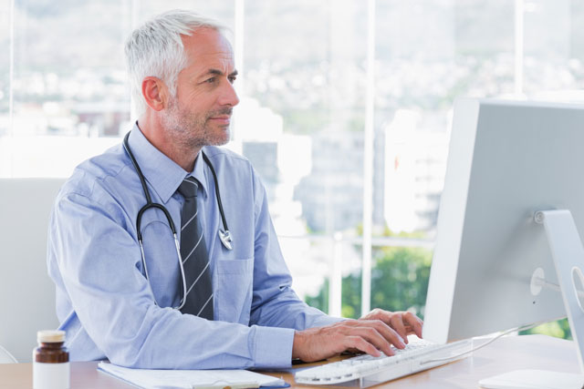 doctor-working-on-computer.jpg